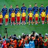 Argentina players line up on the pitch for the National Anthem prior to the 2014 FIFA World Cup Brazil Final match between Germany and Argentina at Maracana on July 13, 2014 in Rio de Janeiro, Brazil.