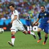 Mats Hummels of Germany controls the ball against Gonzalo Higuain of Argentina during the 2014 FIFA World Cup Brazil Final match between Germany and Argentina at Maracana on July 13, 2014 in Rio de Janeiro, Brazil.