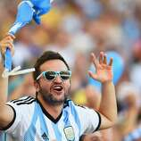 An Argentina fan enjoys the atmosphere prior to the 2014 FIFA World Cup Brazil Final match between Germany and Argentina at Maracana on July 13, 2014 in Rio de Janeiro, Brazil.