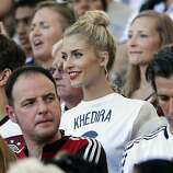 Lena Gercke, the girlfriend of Germany's Sami Khedira, waits for the start of the World Cup final soccer match between Germany and Argentina at the Maracana Stadium in Rio de Janeiro, Brazil, Sunday, July 13, 2014. (AP Photo/Matthias Schrader)