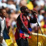 Musician Wyclef Jean (R) and singer Alexandre Pires perform during the closing ceremony prior to the 2014 FIFA World Cup Brazil Final match between Germany and Argentina at Maracana on July 13, 2014 in Rio de Janeiro, Brazil.