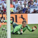Germany's goalkeeper Manuel Neuer watches as the ball flashes past the post during the World Cup final soccer match between Germany and Argentina at the Maracana Stadium in Rio de Janeiro, Brazil, Sunday, July 13, 2014. (AP Photo/Martin Meissner)