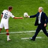 Head coach Alejandro Sabella of Argentina hands the ball to Philipp Lahm of Germany during the 2014 FIFA World Cup Brazil Final match between Germany and Argentina at Maracana on July 13, 2014 in Rio de Janeiro, Brazil.