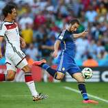 Gonzalo Higuain of Argentina shoots wide as Mats Hummels of Germany defends during the 2014 FIFA World Cup Brazil Final match between Germany and Argentina at Maracana on July 13, 2014 in Rio de Janeiro, Brazil.