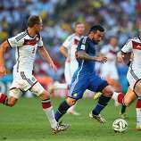 Ezequiel Lavezzi of Argentina controls the ball against Benedikt Hoewedes (L) and Bastian Schweinsteiger of Germany during the 2014 FIFA World Cup Brazil Final match between Germany and Argentina at Maracana on July 13, 2014 in Rio de Janeiro, Brazil.