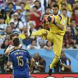 Argentina's goalkeeper Sergio Romero catches the ball during the World Cup final soccer match between Germany and Argentina at the Maracana Stadium in Rio de Janeiro, Brazil, Sunday, July 13, 2014. (AP Photo/Martin Meissner)
