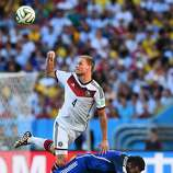 Benedikt Hoewedes of Germany competes for the ball with Ezequiel Lavezzi of Argentina during the 2014 FIFA World Cup Brazil Final match between Germany and Argentina at Maracana on July 13, 2014 in Rio de Janeiro, Brazil.
