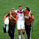 Christoph Kramer of Germany is helped off the field by trainers during the 2014 FIFA World Cup Brazil Final match between Germany and Argentina at Maracana on July 13, 2014 in Rio de Janeiro, Brazil.