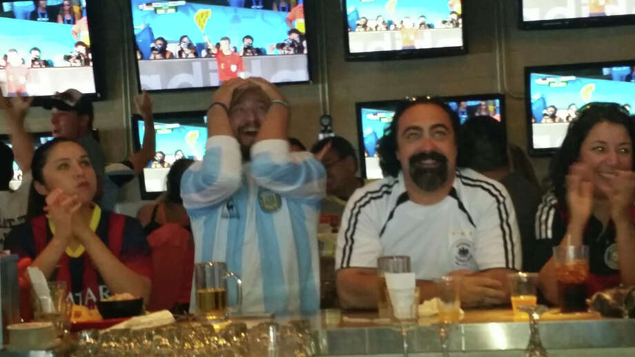 Eddie Bustamante grabs his head in frustration as Argentina misses a sure - shot goal during a World Cup watch party at the sports bar Ojos Locos on the Northwest Side of town. Photo: By J. Almendarez, Express-News