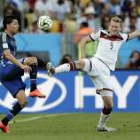 Germany's Andre Schuerrle, right, and Argentina's Enzo Perez battle for the ball during the World Cup final soccer match between Germany and Argentina at the Maracana Stadium in Rio de Janeiro, Brazil, Sunday, July 13, 2014. (AP Photo/Matthias Schrader)