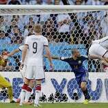 A header from Germany's Benedikt Hoewedes, right, hits the post during the World Cup final soccer match between Germany and Argentina at the Maracana Stadium in Rio de Janeiro, Brazil, Sunday, July 13, 2014. (AP Photo/Matthias Schrader)