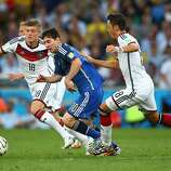 Lionel Messi of Argentina controls the ball against Toni Kroos (L) and Mesut Oezil of Germany during the 2014 FIFA World Cup Brazil Final match between Germany and Argentina at Maracana on July 13, 2014 in Rio de Janeiro, Brazil.