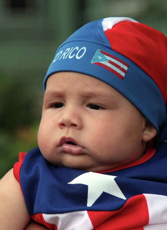 Joshua Perez, 4 mos, of Bridgeport, watches the annual Puerto Rican Parade of Fairfield County in Bridgeport, Conn. on Sunday, June 13, 2014. Photo: BK Angeletti, B.K. Angeletti / Connecticut Post freelance B.K. Angeletti