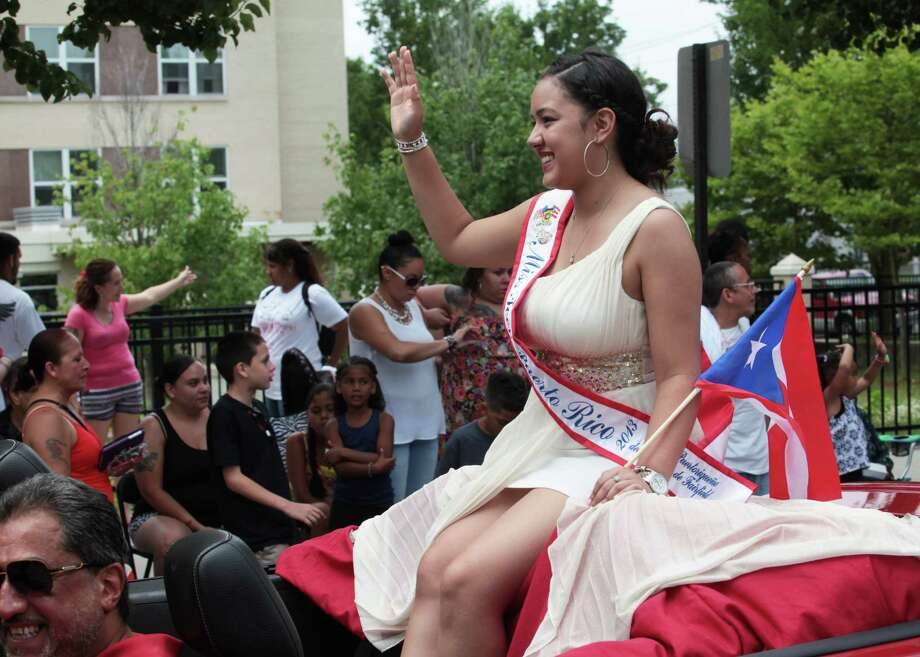 The annual Puerto Rican Parade of Fairfield County heads down Park Avenue in Bridgeport, Conn. on Sunday, June 13, 2014. Photo: BK Angeletti, B.K. Angeletti / Connecticut Post freelance B.K. Angeletti