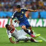Jerome Boateng of Germany challenges Sergio Aguero of Argentina during the 2014 FIFA World Cup Brazil Final match between Germany and Argentina at Maracana on July 13, 2014 in Rio de Janeiro, Brazil.
