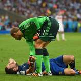 Gonzalo Higuain of Argentina lies on the pitch after a collision as Manuel Neuer of Germany stands over during the 2014 FIFA World Cup Brazil Final match between Germany and Argentina at Maracana on July 13, 2014 in Rio de Janeiro, Brazil.