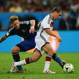 Lucas Biglia of Argentina challenges Philipp Lahm of Germany during the 2014 FIFA World Cup Brazil Final match between Germany and Argentina at Maracana on July 13, 2014 in Rio de Janeiro, Brazil.