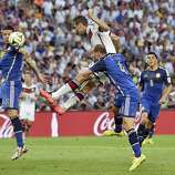 Germany's Miroslav Klose, top center, has a header on goal as he is defended by Argentina's Pablo Zabaleta (4) during the World Cup final soccer match between Germany and Argentina at the Maracana Stadium in Rio de Janeiro, Brazil, Sunday, July 13, 2014.