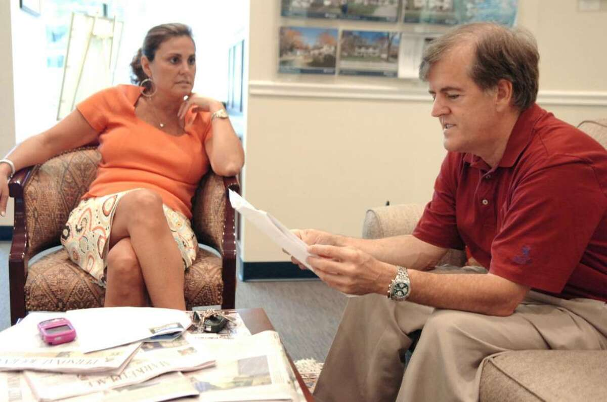 Jose Cortes and his wife Maria Ayala (not pictured), Scarsdale, N.Y., residents, are waiting for the right price to buy a home in Greenwich. Shown talking with Cortes on a house tour last year is Prudential Connecticut Realty agent Julianne Ward.
