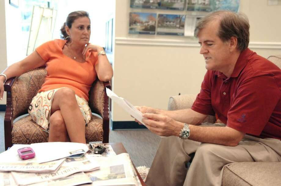 Jose Cortes and his wife Maria Ayala (not pictured), Scarsdale, N.Y., residents, are waiting for the right price to buy a home in Greenwich. Shown talking with Cortes on a house tour last year is Prudential Connecticut Realty agent Julianne Ward. Photo: File Photo / Greenwich Time File Photo