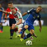 Andre Schuerrle of Germany and Javier Mascherano of Argentina compete for the ball during the 2014 FIFA World Cup Brazil Final match between Germany and Argentina at Maracana on July 13, 2014 in Rio de Janeiro, Brazil.