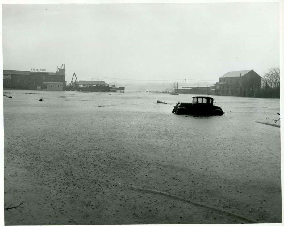 A car on Steamboat Road is partially submerged in flood waters from the great hurricane of 1938. Photo: Contributed Photo / Greenwich Time Contributed