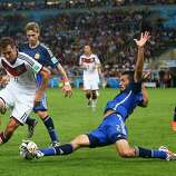 Ezequiel Garay of Argentina tackles Miroslav Klose of Germany during the 2014 FIFA World Cup Brazil Final match between Germany and Argentina at Maracana on July 13, 2014 in Rio de Janeiro, Brazil.