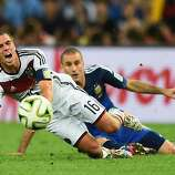 Philipp Lahm of Germany reacts after a challenge by Rodrigo Palacio of Argentina during the 2014 FIFA World Cup Brazil Final match between Germany and Argentina at Maracana on July 13, 2014 in Rio de Janeiro, Brazil.