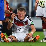 Bastian Schweinsteiger of Germany receives treatment after a collision during the 2014 FIFA World Cup Brazil Final match between Germany and Argentina at Maracana on July 13, 2014 in Rio de Janeiro, Brazil.