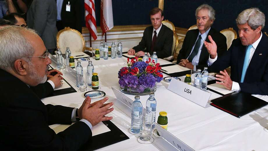 Iran's Foreign Minister Mohammad Javad Zarif (L) meets with US Secretary of State John Kerry (R) during talks between the foreign ministers of the six powers negotiating with Tehran on its nuclear program, in Vienna, on July 13, 2014. Big difference remained in nuclear talks between world powers and Iran on Sunday with fears that an agreement may not be reached before the deadline next week. AFP PHOTO / POOL/ JIM BOURGJIM BOURG/AFP/Getty Images Photo: Jim Bourg, AFP/Getty Images