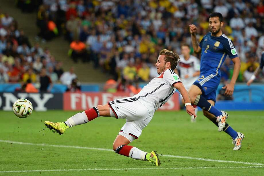 Mario Goetze of Germany scores his team's first goal in extra time during the 2014 FIFA World Cup Brazil Final match between Germany and Argentina at Maracana on July 13, 2014 in Rio de Janeiro, Brazil. Photo: Jamie McDonald, Getty Images