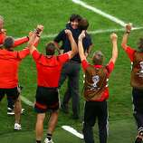 Head coach Joachim Loew of Germany celebrates with assistant coach Hansi Flick and staff after his team's first goal in extra time by Mario Goetze (not pictured) during the 2014 FIFA World Cup Brazil Final match between Germany and Argentina at Maracana on July 13, 2014 in Rio de Janeiro, Brazil.