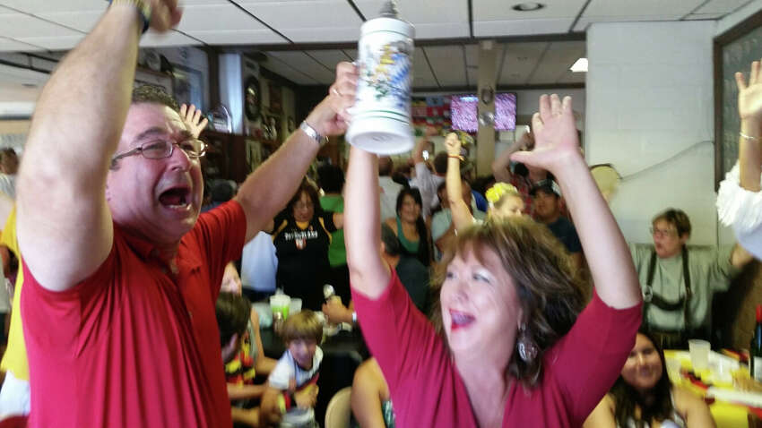 German-born Tom Piasecki, celebrates with Liz Piasecki as Germany scores the first, and thus far only, goal in the World Cup Finals game at Beethoven Maennerchor Halle in South Town.