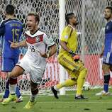 Germany's Mario Goetze celebrates after scoring the opening goal past Argentina's goalkeeper Sergio Romero during the World Cup final soccer match between Germany and Argentina at the Maracana Stadium in Rio de Janeiro, Brazil, Sunday, July 13, 2014.