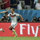 Germany's Mario Goetze, center, celebrates with Andre Schuerrle (9) after Goetze scored the opening goal during the World Cup final soccer match between Germany and Argentina at the Maracana Stadium in Rio de Janeiro, Brazil, Sunday, July 13, 2014. At right is Thomas Mueller (13).