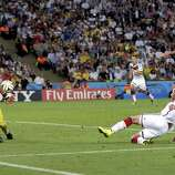 Germany's Mario Goetze kicks to score his side's first goal in extra time against Argentina's goalkeeper Sergio Romero during the World Cup final soccer match between Germany and Argentina at the Maracana Stadium in Rio de Janeiro, Brazil, Sunday, July 13, 2014.