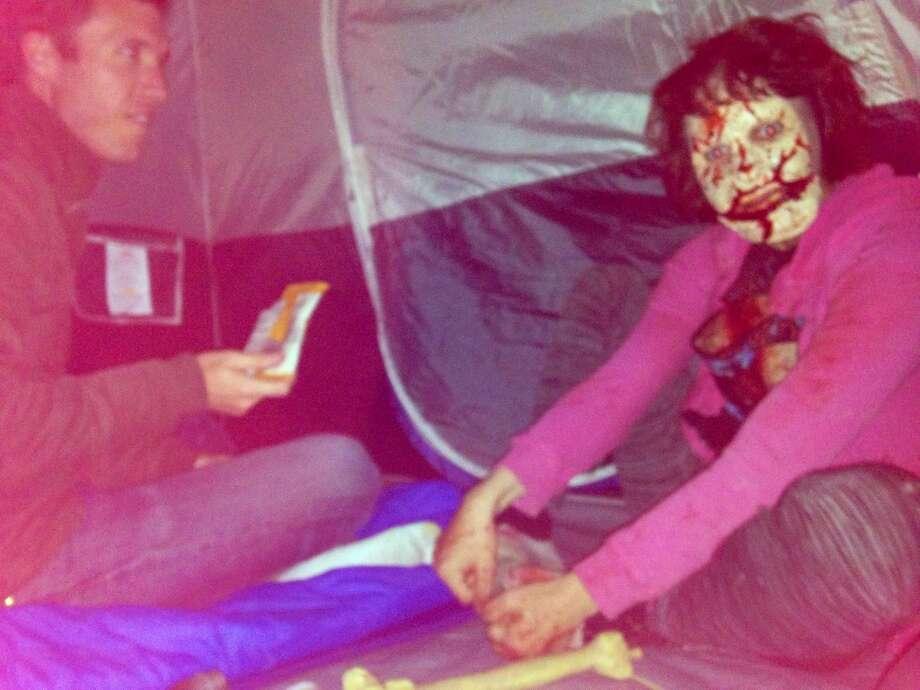 Alex offers a zombie some trail mix.