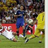 Germany's Mario Goetze kicks to score his side's first goal in extra time against Argentina's goalkeeper Sergio Romero during the World Cup final soccer match between Germany and Argentina at the Maracana Stadium in Rio de Janeiro, Brazil, Sunday, July 13, 2014. (AP Photo/Natacha Pisarenko)