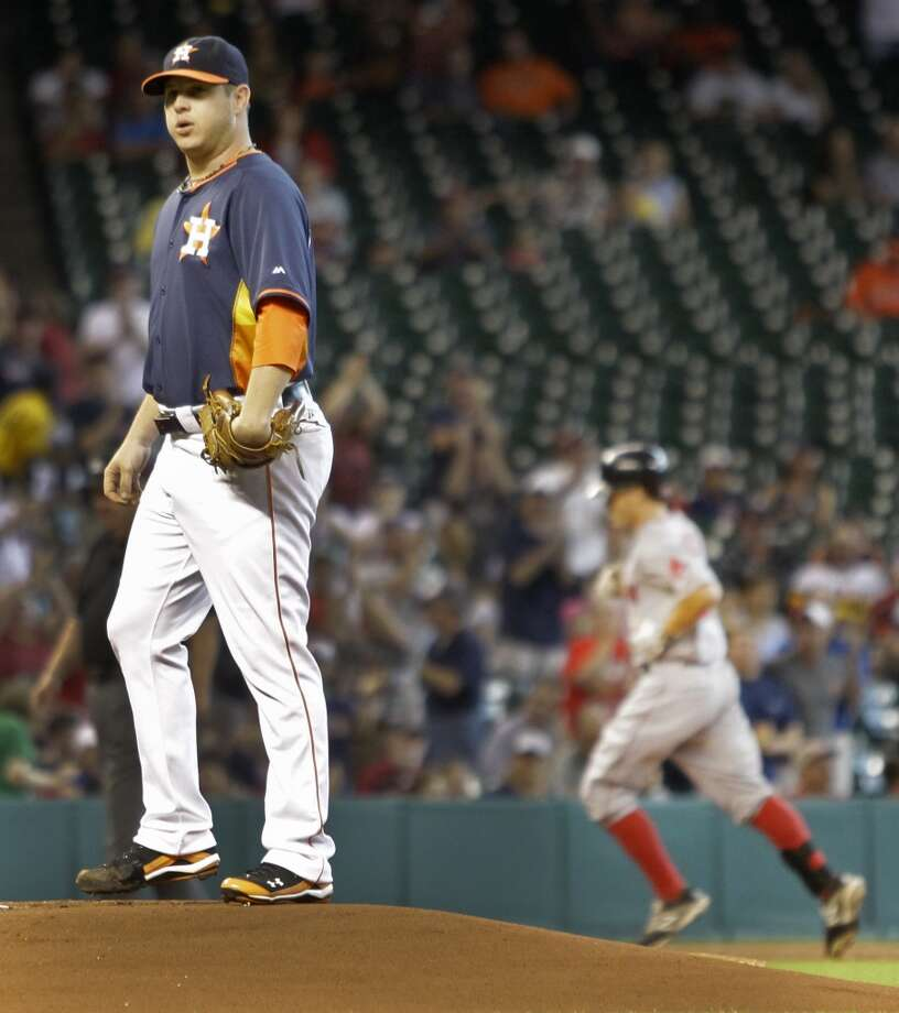 July 13: Red Sox 11, Astros 0  Astros pitcher Brad Peacock waits on the mound as Red Sox Brock Holt rounds the bases after his first inning home run. Photo: Melissa Phillip, Houston Chronicle