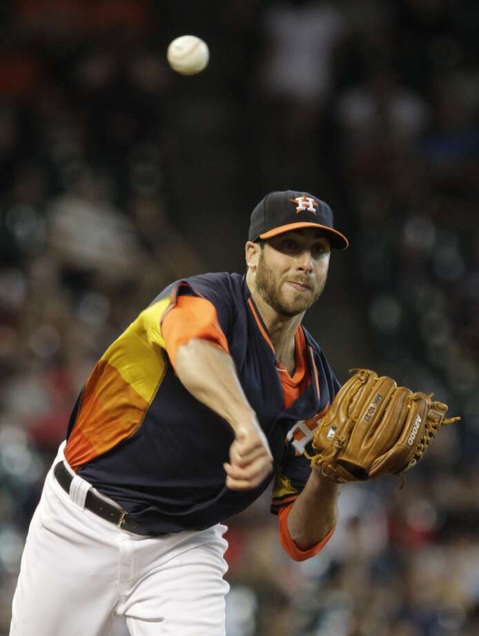 Anthony Bass throws over to first. Photo: Melissa Phillip, Houston Chronicle