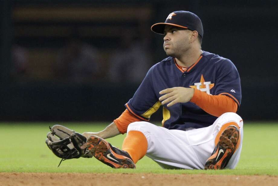 Astros second baseman Jose Altuve sits on the ground after a throwing error. Photo: Melissa Phillip, Houston Chronicle