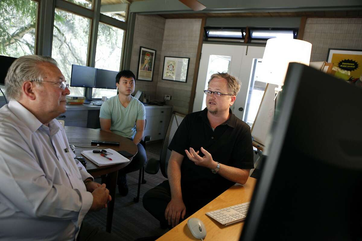 (L-R)Wholesale Change's CEO Robert Morris, market researcher J.R. Cho, co-founder John Denning talk about the latest version of their Well-Planned health insurance website during a meeting at their offices in Santa Rosa, CA, Thursday, July 10, 2014.