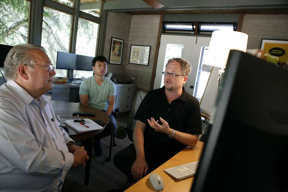 Wholesale Change CEO Robert Morris (left), market researcher J.R. Cho and co-founder John Denning meet in their Santa Rosa office, where the Medicare guide website is being developed. Photo: Michael Short, The Chronicle