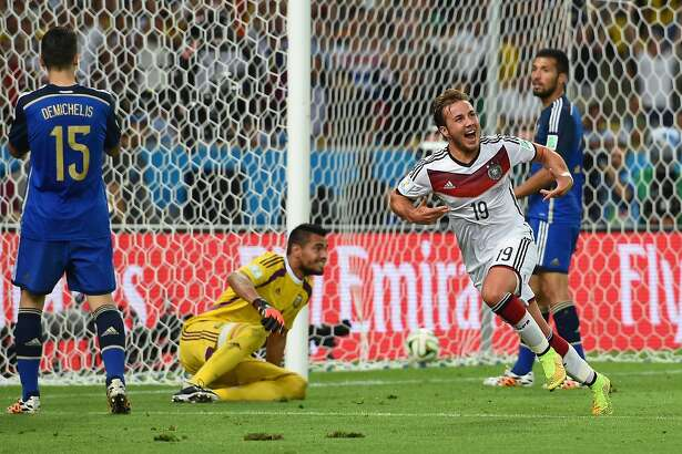 RIO DE JANEIRO, BRAZIL - JULY 13: Mario Goetze of Germany celebrates scoring his team's first goal in extra time during the 2014 FIFA World Cup Brazil Final match between Germany and Argentina at Maracana on July 13, 2014 in Rio de Janeiro, Brazil. (Photo by Matthias Hangst/Getty Images)