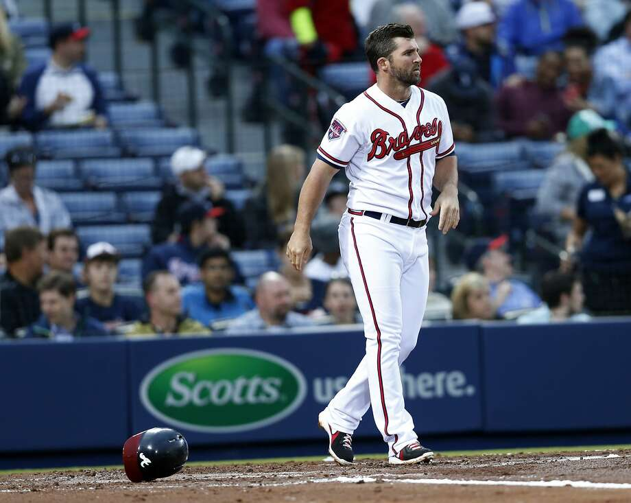 In this April 22, 2014, photo Atlanta Braves' Dan Uggla tosses his helmet after striking out to end the second inning of a baseball game against the Miami Marlins in Atlanta. Uggla's future in Atlanta was in question Sunday, July 12, 2014, after the Braves suspended the struggling second baseman for their final game before the All-Star break. The team announced the suspension on its Twitter feed, with no further explanation. Manager Fredi Gonzalez also declined to elaborate when asked about the punishment before the Braves' game against the Chicago Cubs. (AP Photo/John Bazemore) Photo: John Bazemore, Associated Press