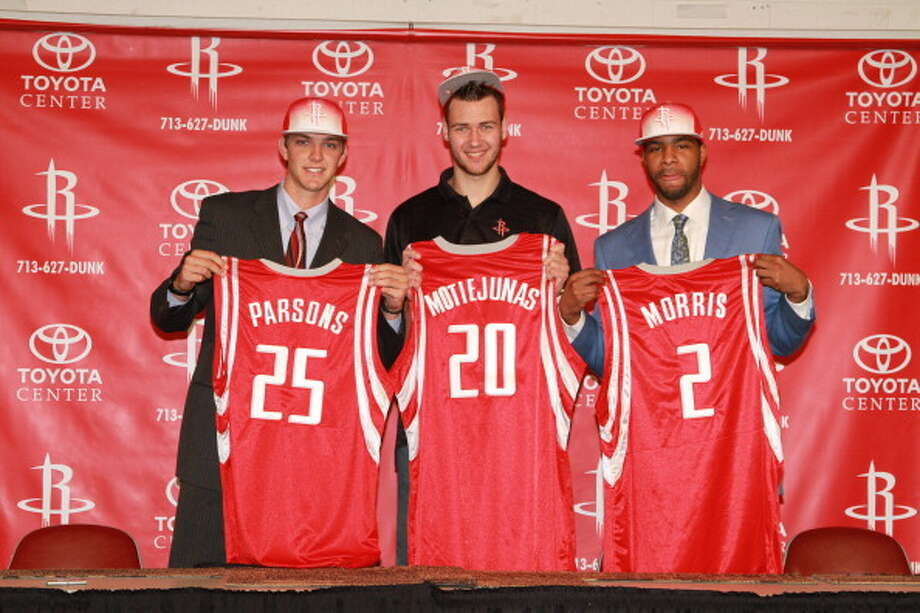 2011 NBA draft   The Rockets ended up with three draft picks after the 2011 draft. Marcus Morris, a power forward from Kansas, was selected 14th overall, Donatas Motiejūnas, a power forward from Lithuania, was selected 20th overall and acquired in a draft-day trade, and Chandler Parsons, a small forward from Florida, was selected 38th overall. Photo: Bill Baptist, NBAE/Getty Images / 2011 NBAE