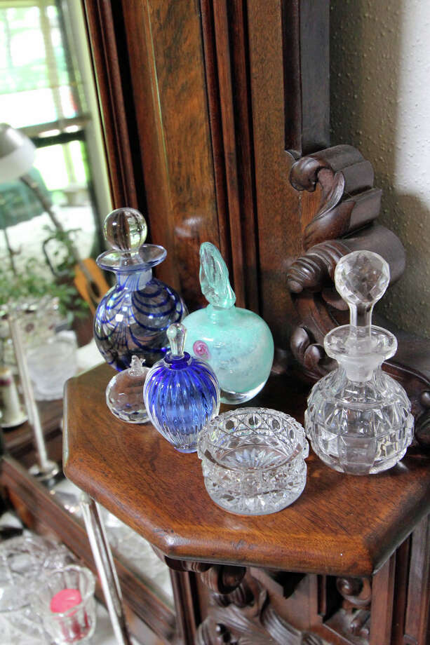 Bonnie Ellison displays pieces from her collection of glass items on her grandmother's antique French dresser. Photo: Danny Warner, Danny Warner / For The Express-News
