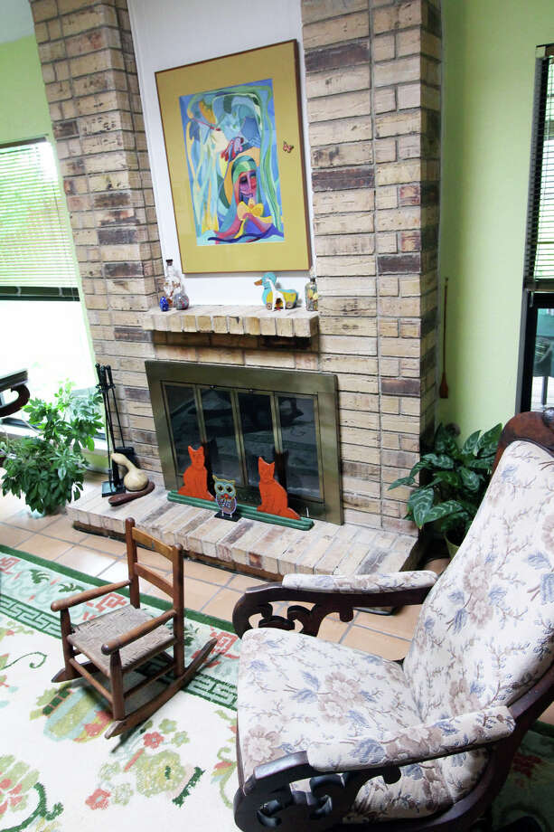 An antique rockers near the floor-to-ceiling brick fireplace. Photo: DANNY WARNER, Danny Warner / For The Express-News / ALL RIGHTS RESERVED UNLESS OTHERWISE SPECIFIED