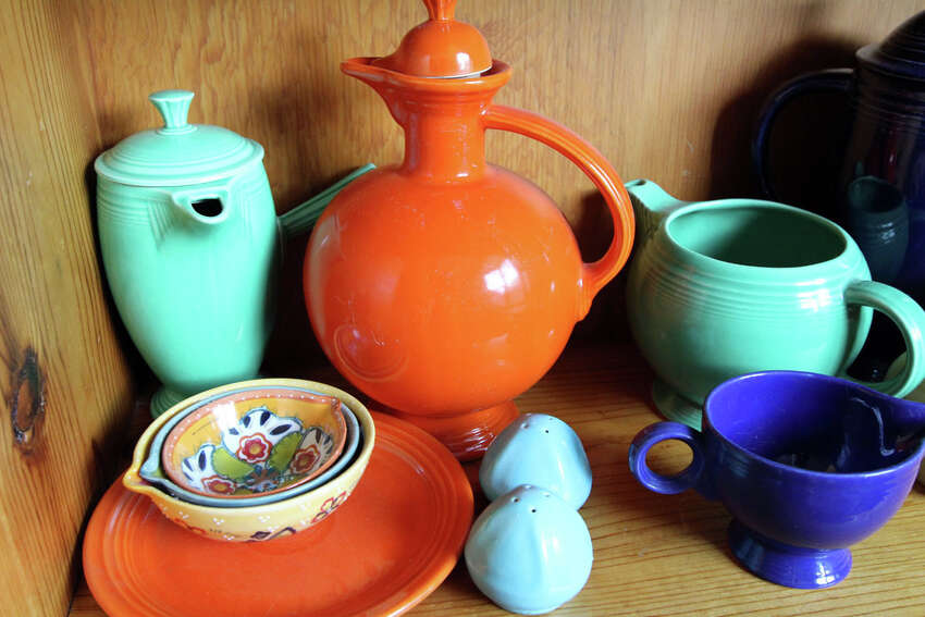 Colorful ceramics are displayed in the home.