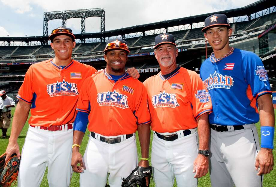 NEW YORK, NY - JULY 14:  U.S. Team Futures All-Stars George Springer #4 and Delino DeShields #11, U.S. Team Futures All-Star coach Keith Bodie #11, World Team Futures All-Star Carlos Correa #1 of the Houston Astros pose in center field prior to the 2013 SiriusXM All-Star Futures Game at Citi Field Sunday, July 14, 2013, in the Flushing neighborhood of the Queens borough of New York City. (Photo by Rob Tringali/MLB Photos via Getty Images) Photo: Rob Tringali, MLB Photos Via Getty Images